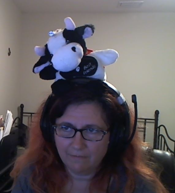Karina wearing a laser cow on her head